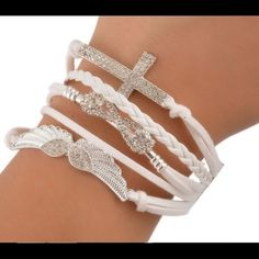 """White multilayer wings, infinity & cross bracelet! Striking white, in color, fashion bracelet. Soft suede like woven material with alloy metal ends and clasp closure. Measures 9"""" in length. Length of just bracelet only part is 6.5"""". Bracelet width is 2.5"""".  If measuring width from top middle part of wing to shorter end tip of cross it is 4.5"""" in width. Accessories"""