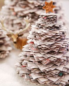 newspaper's xmas trees: I had a Mr & Mrs Santa made from news papers a long long time ago.