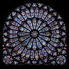 Rayonnant rose window in Notre Dame de Paris. Light was considered as the most beautiful revelation of God, as was manifested in Gothic architecture.
