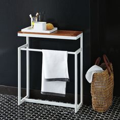 Gives another (sm) surface in (now) smaller bathroom. On sale for $69. Have 2 smaller tables that may also work - but this gives me an alt. idea.