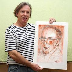 Gazmend Freitag with his portrait of Ismail Kadare