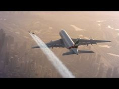 Just Two Guys With Jetpacks Cruising Alongside A Jumbo Jet http://amapnow.com http://my.gear.host.com http://needava.com http://renekamstra.com
