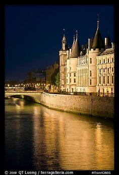 Conciergerie reflected in Seine at night. Paris, France