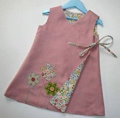 Criss-Cross Reversible Wrap Cross Over Dress par PeachPatternsCRISS CROSS Reversible Dress Wrap Dress by Wink Designs winkhandmade on Etsy. Lovely flowers embellished on the front.The Criss-Cross Reversible Dress for Girls PDF Sewing Pattern in Sizes Sewing Clothes, Doll Clothes, Dress Sewing, Sewing Coat, Apron Dress, Fashion Kids, Reversible Dress, Little Girl Dresses, Baby Dresses