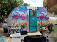 Artfully painted camper with pink flamingos on the beach! Via: http://www.getawaygals.com/Getaway_Gals/News_Articles.html