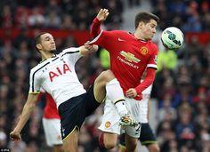 Spurs' Nabil Bentaleb (left) challenges United's Ander Herrera in the midfield as the visi...
