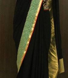BLACK BEAUTY- georgette intoxication georgette-saree @ www.mirraw.com