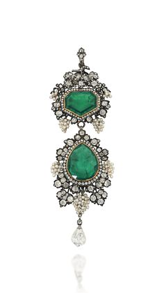 A LATE 19TH / EARLY 20TH CENTURY EMERALD AND DIAMOND BROOCH / PENDANT -  The surmount with fancy-cut emerald and single-cut diamond cluster centre, to a fruiting vine surround, composed of bunches of seed pearl grapes among old-cut diamond-set vine leaves, suspending a pear shaped emerald drop with similarly-set seed pearl and diamond border, to a further briolette-cut diamond terminal, mounted in silver and gold.