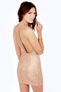 """The party doesn't start until you walk in wearing the Life of the Party Champagne Sequin Dress! Enjoy the benefits of a bodycon fit as it hugs your curves on a sleeveless bodice with side darts, and a sexy T-back that displays a daring amount of skin. Round sequins cover all for an elegant shimmer that stands out from the crowd. Hidden back zipper/hook clasp. Lined. Model is 5'9"""" and is wearing a size small. 100% Polyester. Dry Clean Only. Imported."""