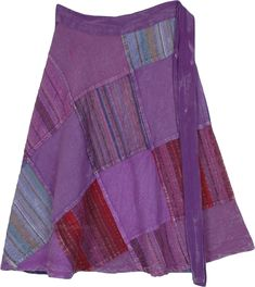 This beautiful purple gypsy skirt makes you feel glam, at the same time light and breezy. With its solid purple stonewashed patches interspersed with colorful striped fabric with added shades of red and blue, this gorgeous purple skirt looks distinct from afar and near. #tlb #Patchwork #WrapAroundSkirt #PassionPurpleSkirt