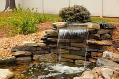It's time to beautify your yard with a nice water feature in the back yard courtesy of P & L Landscaping!