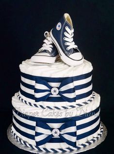 Boy's Diaper Cake Topped with a Pair of Converse Running Shoes www.facebook.com/DiaperCakesbyDiana #runningshoes
