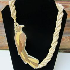 Huge statement necklace! Beautiful inlaid wood detail on the bird which measures about 6 inches tall. The thicker multi strand chain is made from
