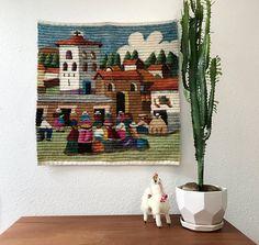 Vintage Peruvian wool tapestry depicting a village gathering, 2' x 2'