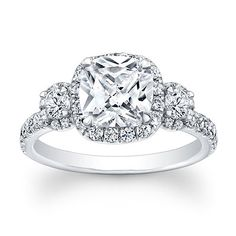 Beautiful 1.30 carat Cushion Cut Forever Brilliant Moissanite in a Halo Style setting. The center stone is surrounded with an additional 46 diamonds