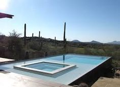 This trapezoid shaped pool was designed to capture the - Invisible edge pool ...
