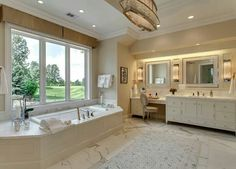 Large bathroom.  Very sleek and beautiful.
