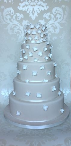 Pretty 5 tier wedding cake with scattered white hydrangea. Wedding cakes London, Hertfordshire, Essex and Kent.