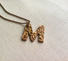 Copper Metal Clay Custom Textured Letter Necklace. $16.00, via Etsy.