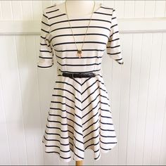 """Lost stripped skater dress with belt Lost Stripped skater dress with belt. Purchased online from Tillys. Dress include belt. Size small, fits true to size. Measures 32"""" from shoulder to hem. Sleeve measures 11.5"""". Pre-loved condition. I styled this with wedges and a long necklace. No trades, reasonable offers welcome 😄 Lost Dresses"""