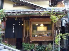 "'Inside Kyoto' says, of Kasagiya in Southern Higashiyama, ""The most atmospheric little tea house in Kyoto, we never pass this way without stopping in for a hot cup of matcha tea and a sweet"""