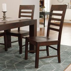 Crafted of solid rubberwood with a distressed mahogany finish, our rustic ladder-back side chairs boast a chunky profile with legs that protrude slightly to the surface of the seat.