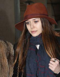 Elizabeth Olsen wearing a brown fedora hat.
