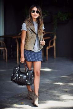 Shop this look for $874:  http://lookastic.com/women/looks/vest-and-crew-neck-t-shirt-and-mini-skirt-and-ankle-boots-and-satchel-bag/2527  — Olive Leather Vest  — Grey Crew-neck T-shirt  — Navy Polka Dot Mini Skirt  — Brown Suede Ankle Boots  — Black Leather Satchel Bag