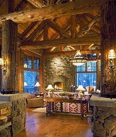 """Massive 12"""" and 14"""" logs in this gorgeous log home (need a different couch...can't do the Southwestern theme!). But otherwise, it's a beautiful place :)"""
