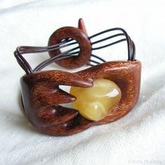 Hand-carved, wooden bracelet with natural baltic amber. Bracelets width: 3.5 cm; Circuit of a bracelet: 17.5 cm;