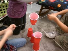 Science Gal: Setting Expectations for Group Work - Tie 4 strings around an elastic and the kids have to stretch the elastic as a team to pick up red solo cups and place them in a configuration. Also has ideas for individual roles that can be rotated.