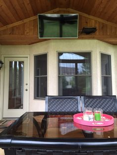 Screened Porch Decorating Ideas | Home & Plate | www.homeandplate.com | This is my husband's favorite seat in the house.