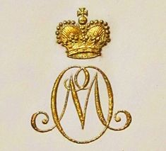 "Gold ""M"" monogram with a Crown"