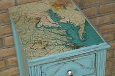 Mod Podge a map to a tabletop. A cool way to cover damaged wood. Perfect for my old bench that I just got.