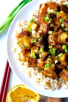 Enjoy a bowl of delicious Crispy Orange Tofu with Sticky Orange Sauce rather than takeout. Crispy cubes battered tofu is served in a sweet, sour glaze. #vegan