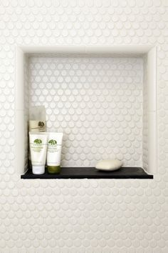 White penny tile as accent tile in niche and above vanity countertop-