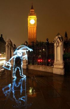 """""""Aug 18, 2009 - London, England, United Kingdom - These amazing 'light graffiti' long exposures were formed by artist Michael Bosanko. PICTURED - Light graffiti of a man with an umbrella, outside Big Ben and the Houses of Parliament, London, UK."""""""