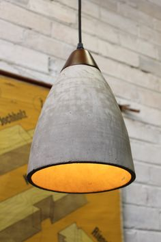 How beautiful is this concrete pendant light? The contrasting timber top is a great detail.