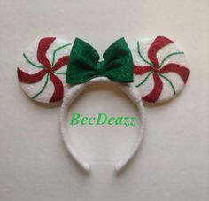 Show off at the parks with these adorable Peppermint Candy Mouse ears headband! Ears are completely covered in glitter. They sparkle so