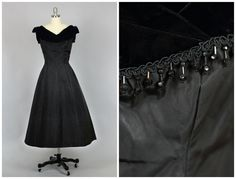 Vintage 1950s formal gown with silk velvet trim and black jet bead fringe. This fabulous gown has a built in crinoline with a contrasting red