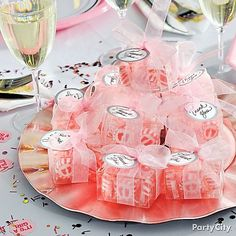 Create a great centerpiece with your baby shower favors by filling clear containers with candy.