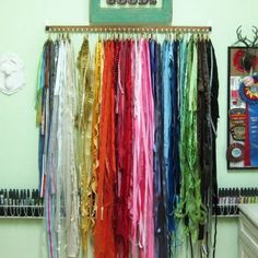 Beautiful way to organize scarves with shower curtain hooks,