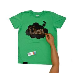 Chalkboard T-shirt for kids! What a great idea! These come in different colors with different designs that kids can write on, just like a chalkboard! Shirt also has a handy little pocket (black spot on bottom left) for the chalk that comes with the shirt.
