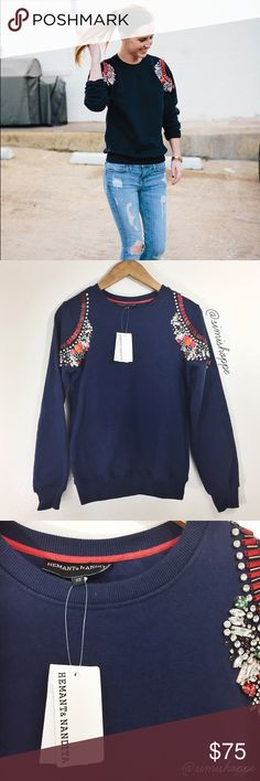 NEW XS Anthropologie Jewel Embellished Sweater BRAND: Hemant & Nandita (Anthropologie) ITEM: An insanely gorgeous navy blue sweater from Anthropologie (Hemant & Nandita) in a classic crewneck sweatshirt fit. Features stunning jewel crystal embellishments on the front shoulders and comes with some replacement jewels. | 100% Cotton | NWT - New With Tags | NO FLAWS SIZE: XS (best fits XS/S) | Pit to Pit: 18"