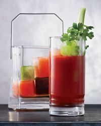 """UNIQUE Aviary's Bloody Mary - As the colorful ice cubes melt in the cocktail, they slowly season the drink: The green cubes are made with celery, the black ones use Worcestershire sauce and the red cubes get their color and flavor from Fresno chiles. This way, he says, """"the palate doesn't get bored. The drink is 'new' with every sip.""""Recipe on Food & Wine"""
