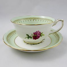 Stunning tea cup and saucer set with large rose in the center. Gold trimming on cup and saucer edges. This beautiful piece was made in England by Hammersley and Co. Excellent condition (see photos). Markings read: Bone China Hammersley & Co Made in England Please bear in mind that