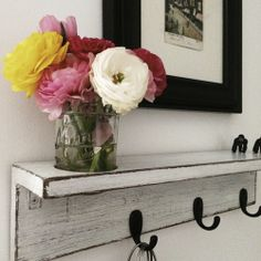 this shelf, and the cutout for a jar of flowers.