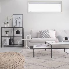Nordic minimalist living room with space metal furniture for a more airy atmosphere. Against the wall is the Ikea VITTSJÖ shelf. The white table is the Don't Leave Me table by Thomas Bentzen for Hay in Denmark.