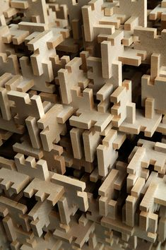 Puzzling by Anton Alvarez A single wood module industrially multiplied into thousands, designed in a way to be joined without glue.