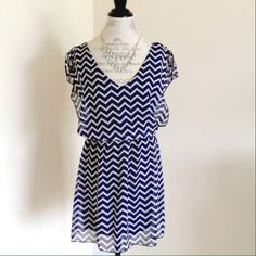 NWOT! Amazing blue/white chevron dress! It's really light and sheer with a built-in dark blue slip. I LOVE this dress, I hate selling but I just never wore it (I'm just not a dress person unless going OUT out)...tags were removed when I packed it to go on vaca but I never ended up wearing it:-( hard to part with but time to sell...thanks for looking! Dresses